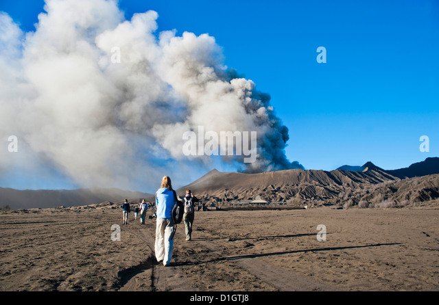 Tourists watching Mount Bromo, an active volcano, erupting in East Java, Indonesia, Southeast Asia, Asia - Stock Image