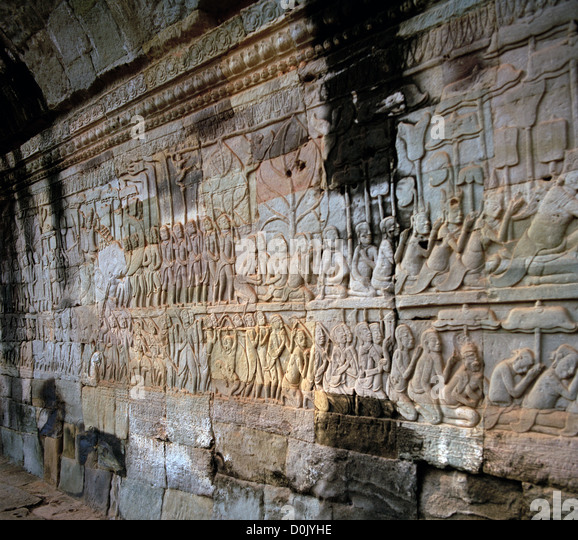Bas relief sculpture carvings at the Bayon Temple of Angkor Thom at the Temples of Angkor in Cambodia in Southeast - Stock Image