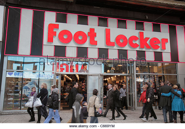 Manhattan New York City NYC NY Midtown Times Square storefront entrance signage Foot Locker chain business athletic - Stock Image