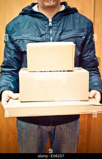 man delivering packages - Stock Image