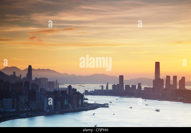 Hong Kong Island and Tsim Sha Tsui skylines at sunset, Hong Kong, China, Asia - Stock Image