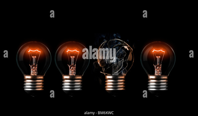 One burn out light bulb in a row of good ones - Stock-Bilder