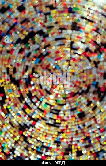 Glass beads with sun shining through them. - Stock Image