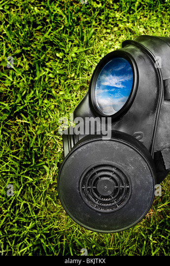 Gas mask on green grass - Stock Image