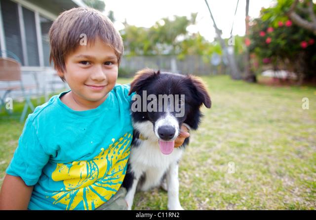 Boy with his Border Collie dog - Stock-Bilder