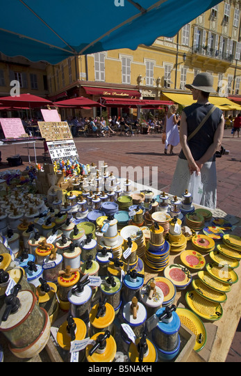 France French Reviera Nice Cours de Saleya market stall with provencial ceramics Les Ponchettes street Cafe - Stock Image