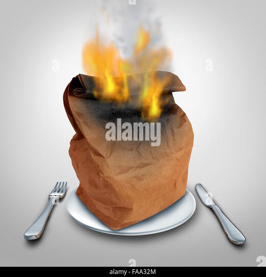 Burning calories or burn calorie concept and hot lunch idea or food waste symbol as a brown paper lunch bag that - Stock Image