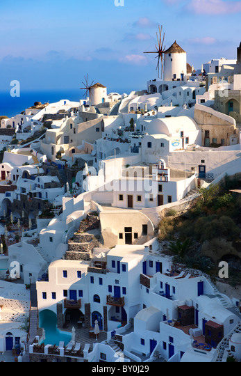 Oia ( Ia ) Santorini - Windmills and view of town , Greek Cyclades islands - Photos, pictures and images - Stock Image