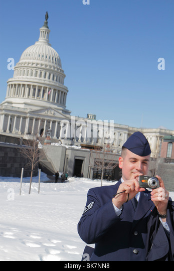 Washington DC United States US Capitol visitor center tour snow winter dome government Congress Air Force man officer - Stock Image
