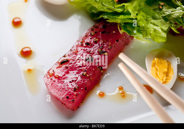 Raw fish tuna with salad - Stock Image