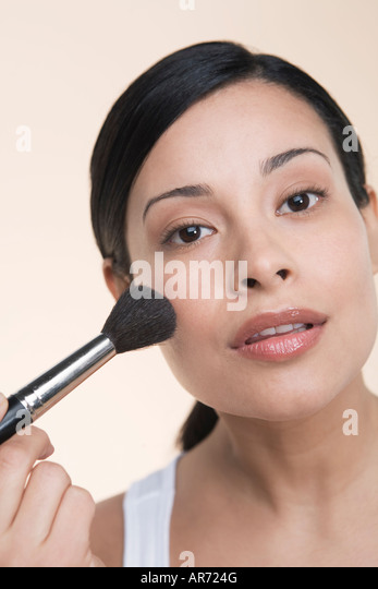 Woman applying makeup - Stock-Bilder