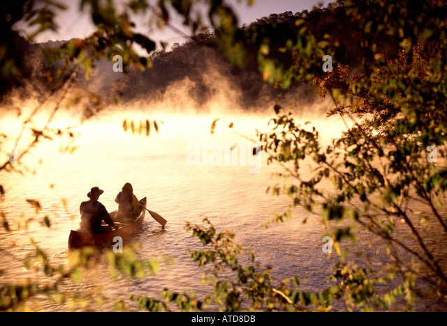Canoeing Bear Rock Lake North Carolina In The Morning Fog - Stock Image