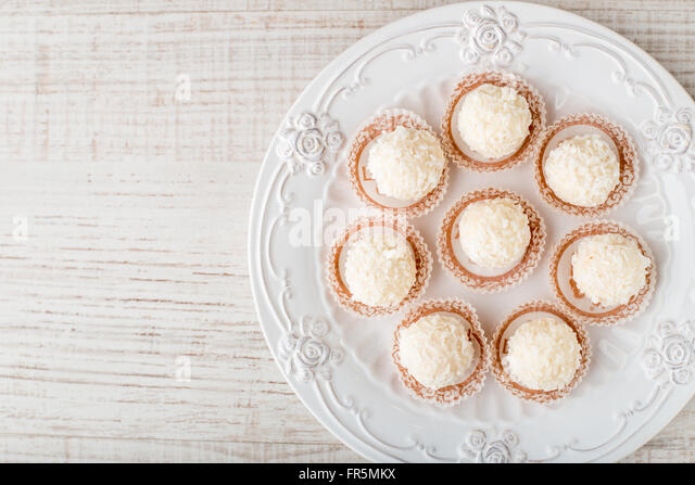 Candy coconut flakes on a plate horizontal - Stock Image