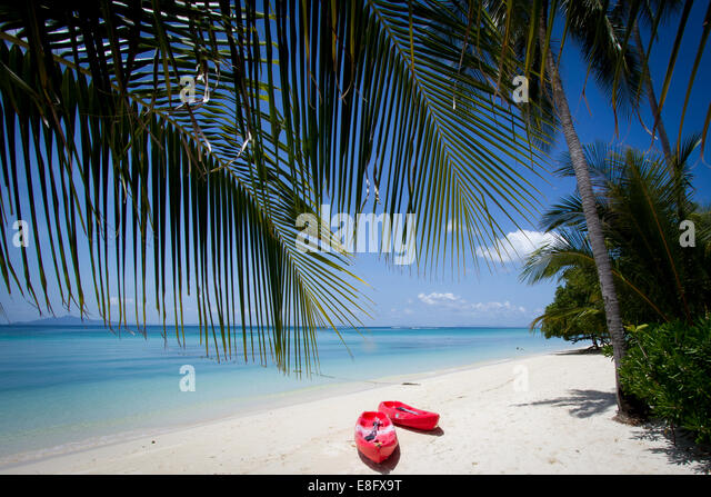 Thailand, Phuket, View of boats left on beach - Stock Image