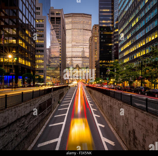 Car light trails in Park Avenue South, Midtown, Manhattan. Evening light on New York City skyscrapers and Grand - Stock Image