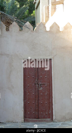 A traditional Arabian door with beautiful design on an old Arabic house - Stock Image