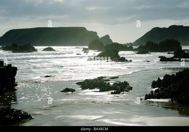 Evening light on Marloes Sands empty rocky beach  Wales,Pembrokeshire,UK - Stock Image