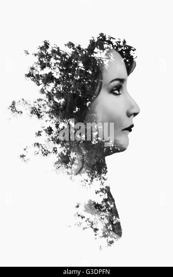 Women double exposure with forest - Stock Image