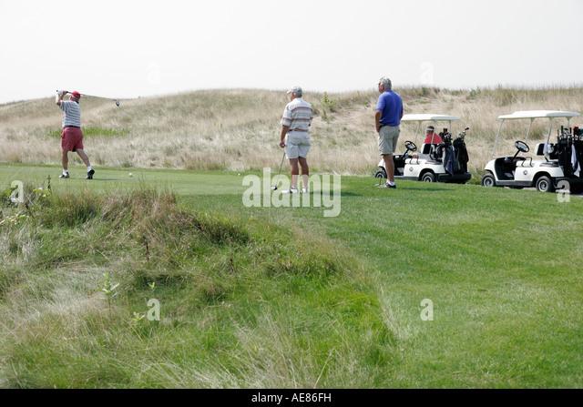 Toledo Ohio Oregon Maumee Bay State Park Scottish Links Golf Course male players tee cart - Stock Image