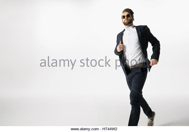 Cool businessman running against white background - Stock-Bilder