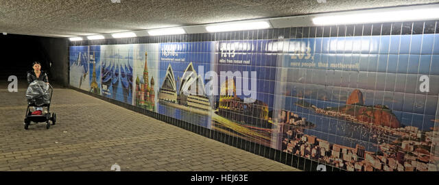 Motherwell Town Centre Underpass at night,Lanarkshire,Scotland,UK - with young mother / pushchair / baby - Stock Image