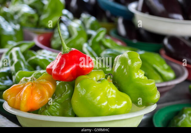 Red pepper known as Bishop Crown or Christimas Bell. Selective focus, blurred background - Stock Image