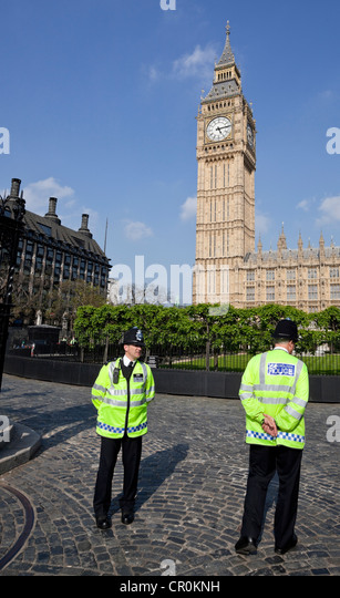 Two policeman guarding one entrance of The House of Parliament, London, England, UK - Stock Image