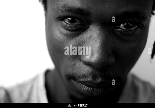 Portrait Of Man Against White Background - Stock Image