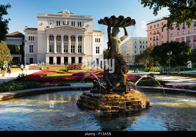 Baltic, Latvia. The fountain in front of the opera and ballet theater in Riga on a sunny summer day - Stock Image