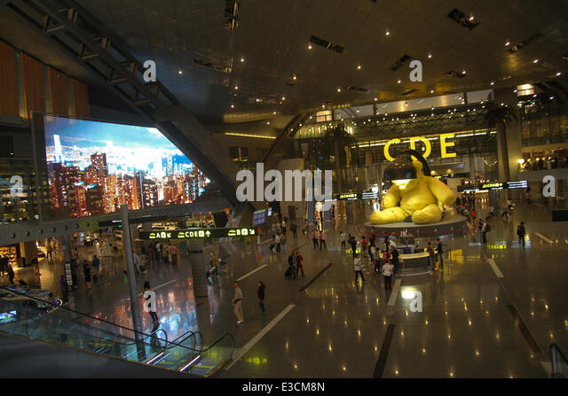 Doha, Qatar, 22nd June, 2014. Passengers seen walking in the concourse of the new Hamad International Airport (HIA) - Stock Image