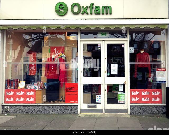 Oxfam Charity Shop with Appeal for Zimbabwe Colera - Stock Image