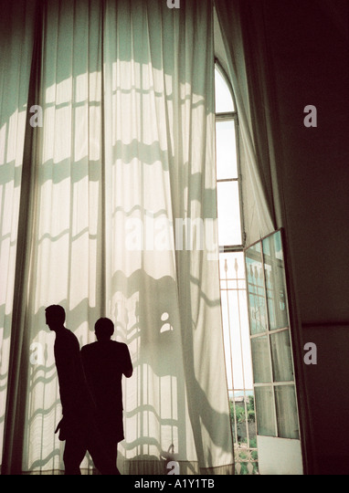 Hospital window, Sienna, Tuscany Italy. Atmospheric 35mm snap image with considerable visible film-grain. - Stock Image