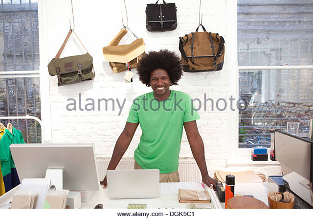 Mature man working in shop - Stock Image