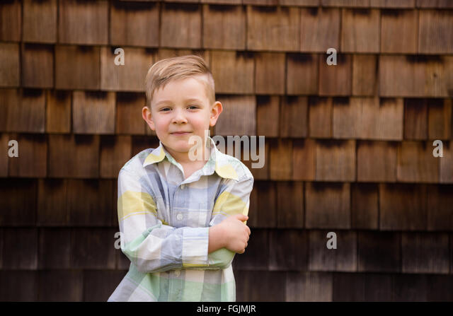 Young boy outdoors in a lifestyle portrait with natural light. - Stock-Bilder