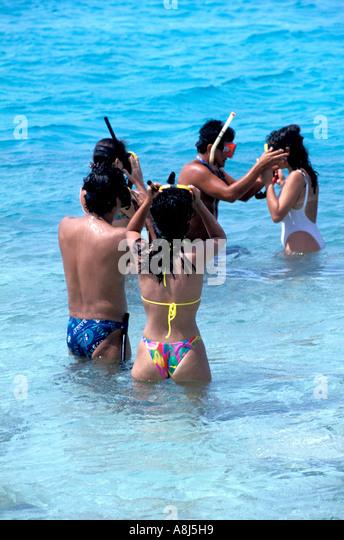 Snorkelers standing shallow water Los Roques Archipelago National Park Venezuela - Stock Image
