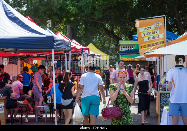 Brisbane Australia Queensland West End Davies Park Saturday Market shopping flea market vendors stalls sale man - Stock Image