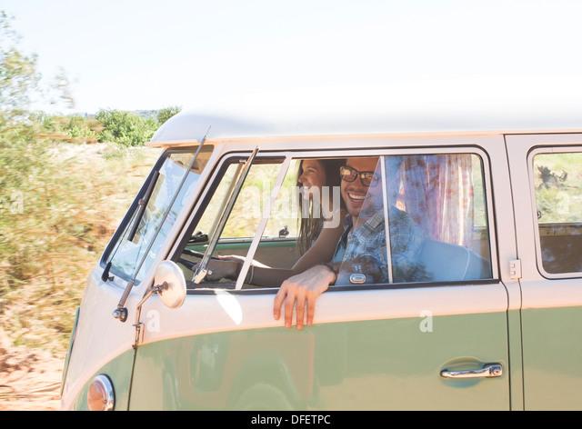 Couple in camper van - Stock Image