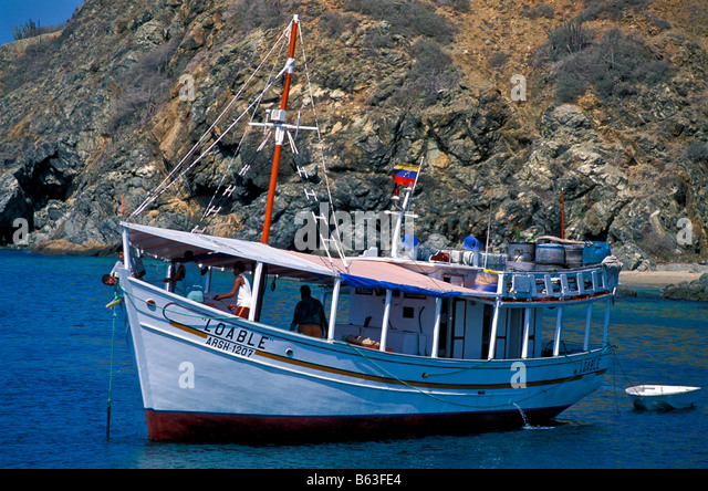 Venezuela Isla Margarita island fishing boat La Caracola cove Porlamar City Venezuela south america tourism south - Stock Image