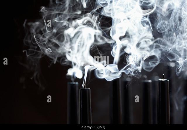 Close up of smoking black candles - Stock-Bilder