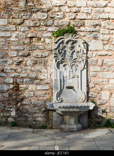 Marble sculpted drinking fountain at Gulhane Park, Sultan Ahmet district, Istanbul, Turkey - Stock Image