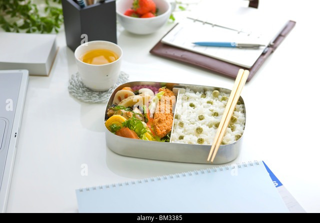 Bento box (Lunch box) on a desk - Stock Image