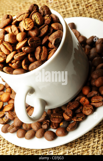 Cup full of coffee beans close up - Stock Image