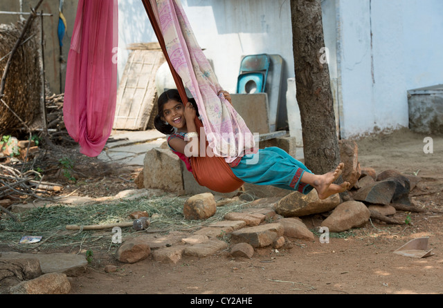 Young girl swinging indian stock photos young girl for Swingvillage