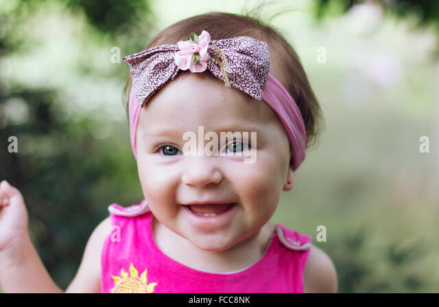 Close-Up Of A Cheerful Baby Girl - Stock Image