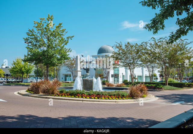 A large fountain and artwork great shoppers on the main street into The Shoppes at Eastchase shopping center in - Stock Image