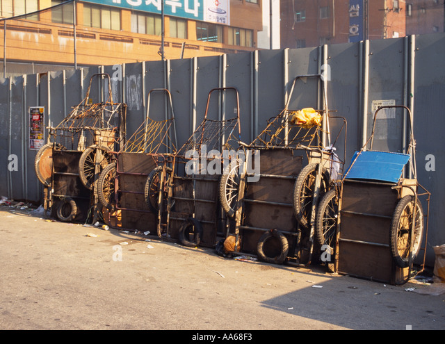 Carts resting against wall in downtown Seoul Korea - Stock Image