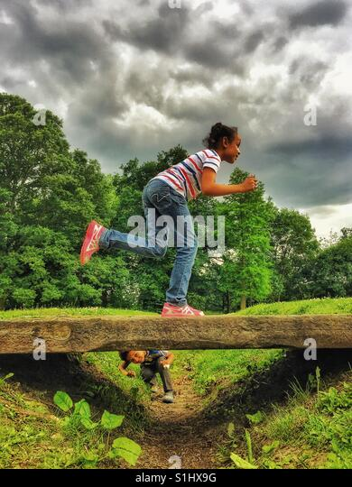 Kids playing in the park. - Stock Image