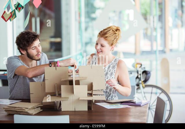 People building model together - Stock-Bilder