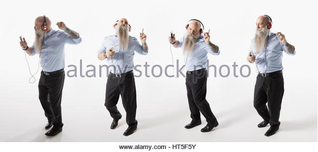 Sequence hipster businessman with beard dancing, listening to music with headphones against white background - Stock-Bilder