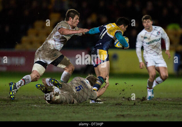 Worcester, UK. 07th Feb, 2014. Louis DEACON and Ed SLATER (Leicester Tigers) tackle David LEMI (Worcester Warriors) - Stock Image
